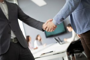 Business people shaking hands, finishing up meeting